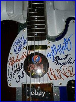 Owsley Stanley belt buckle and Grateful Dead autographed guitar and LP with COA
